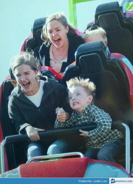 Scared kid on a rollercoaster