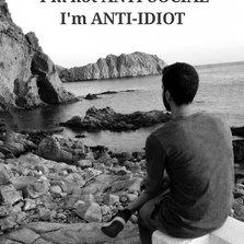 cool-man-siting-rocks-sea-anti-social